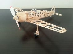"Balsa model, Focke Wulff. German WWII Airplane Kit, Wing Span: 16½""  Scale: 1/30 http://www.guillow.com/focke-wulffw-190.aspx.  I painted the nose cone to look like wood. Not bad fot the first balsa model."