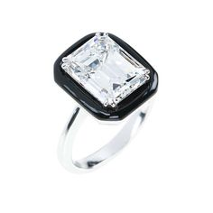 """Emerald-cut diamond engagement ring in white gold and black enamel from Nikos Koulis fine jewellery """"Oui"""" collection."""