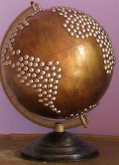 Upcycled nailhead globe via etsy--Not exactly sure why I like this. I would like to buy an old globe spray paint and put countries with jewels or pearls. now just finding an old globe. Globe Projects, Diy Projects, Globe Crafts, Map Crafts, Art Globe, Painted Globe, Deco Kids, World Globes, Globes Terrestres
