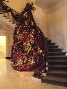 Beautiful Christmas Trees. i want a spiral staircase just so i can put my tree there. so pretty.
