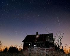 Leonid meteor shower over an abandoned house in New Jersey