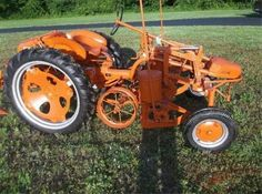 ALLIS-CHALMERS G W/CORN PLANTER...a produce farm would have a bunch of these with all kinds of attachments...job specific tractor.