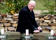 Keith Moulton, whose daughter and two grand daughters were among those killed at the Port Arthur massacre, lays a floating candle in the reflection pool at the memorial site.