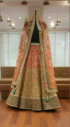 peach lehenga,pastel lehenga,coral lehenga,all over work dupatta,heavy gold work,peach and gold,bridal lehenga,morning wedding lehenga,sister of the bride outfit,summer wedding lehenga. coral net lehenga