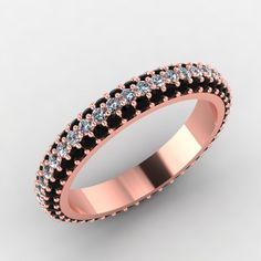 rose gold wedding band with black and white diamonds. style 6RGDBL. $1,850.00, via Etsy.