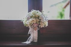 White flower bridal bouquet wrapped in lace | Photography by http://www.sallytphotography.com/