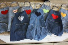 Repurposed denim craft aprongs for kids. Made from pant leg of jeans, using hem of jeans for bottom hem of apron. Back pockets are removed and resewn to apron front. Apron straps are made from the flat felled side seams of the jeans. Jean Crafts, Denim Crafts, Fabric Crafts, Sewing Crafts, Sewing Projects, Art Projects, Upcycled Crafts, Project Ideas, Repurposed