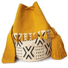 The stunning, one-of-a-kind Wayuu bag has been carefully crocheted by indigenous women from the desert of La Guajira, Colombia. Hippie Bags, Boho Bags, Crochet Handbags, Crochet Bags, Boho Crochet, Tapestry Crochet Patterns, Denim Handbags, Tapestry Bag, Purses And Bags