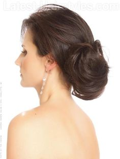 Simple, elegant, messy low chignon with a soft, side swept fringe