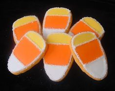 Candy Corn Cookies Recipe: cookie dough your choice, yellow gel paste food coloring, white yellow and orange blood icing, corn syrup and sparkling sugar. †▼▼†