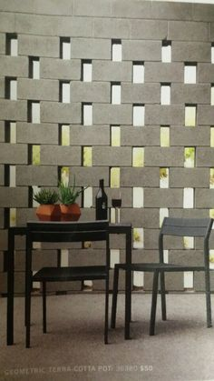 Open cinder block wall created by staggering the blocks. From the Design Within Reach catalog. Wind break idea for fire pit area Backyard Privacy, Backyard Fences, Backyard Landscaping, Landscaping Ideas, Concrete Block Walls, Cinder Block Walls, Cinder Blocks, Cinder Block Ideas, Cinder Block House