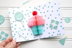 Watch a recent YouTube project video showing how to make a festive pop-up cupcake birthday card using honeycomb pads from the We R Memory Keepers DIY Party collection.