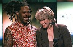 Busta Rhymes and Martha Stewart take the stage to present an award together at the 1997 VMA's.