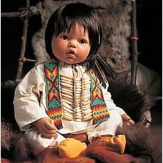 Lee Middleton - My Collection:  2002  #735  Native American Baby  $208.00  Series:  Faces of America  Face:  Baby Face  Artist:  Reva SCHICK