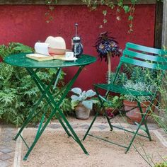 A small patio becomes a verdant oasis with potted plants. Low-water options, such as sedum and Russian sage, require little care.    About $14 for one plant;