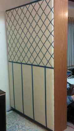Home-made french bulletin board for the back of a bookcase being used as a room divider