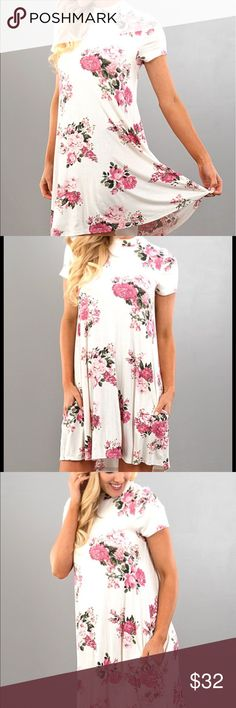 << Brighter Days Floral Midi Dress >> Floral perfection! This little dress is a perfect spring/summer trend dress! White and light pinks for a cute and classy look, all while keeping a modest hemline. Also it has pockets!!! Rayon Poly blend for a light and airy wear Boutique Dresses