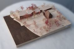 Wooden architectural model with autumnal trees and coast line