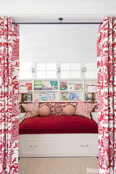 """The children's library doubles as a guest room for sleepovers in a Houston, Texas, house. """"The children's reading room is a niche carved out of a hallway,"""" designer Ann Wolf says. """"It's a private, magical little space at the heart of the house, where you imagination can run wild."""" Shelves are designed to display book covers. Curtains are Pierre Frey's Alpage.   - HouseBeautiful.com"""
