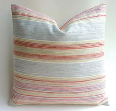 One designer Grey Multicolor striped pillow cover with a wonderful soft complex woven texture. In addition to Grey and white, the fabric includes