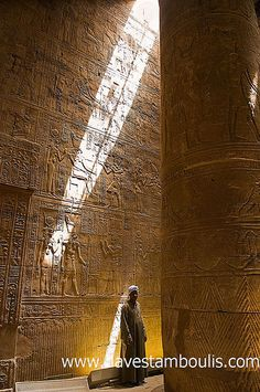 striking light filters in to the Horus Temple at Edfu in Egypt