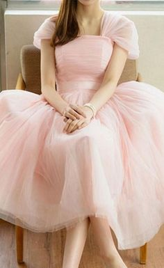 I've never been much of a pink or fluffy dress kind of person, but for some reason this dress makes me smile.