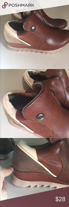 """NWT leather look booties with hidden wedge heel Cream and and brown leather look booties with a hidden heel (provides ~3/4"""" lift over the sole of the shoes). Very comfortable around the ankle too. DBDK Fashion brand. Bottom closure makes them easy to put on and elastic strap in shoes keeps everything tight and comfortable. Shoes Ankle Boots & Booties"""