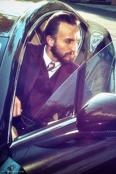 Car: Aston Martin Rapide S. Him: Shirt & suit by Vivienne Westwood Man. Necktie by COLUNGA.