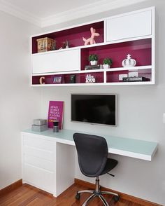 Love the pop of burgundy inside the cabinets/shelves