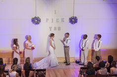 The NotWedding Charlotte by Nicole Caudle Photography  Ceremony backdrop:Simple Southern Wedding and Event Design Wedding and Bridesmaid dresses:Fabulous Frocks  Ceremony Musician: Event Performances