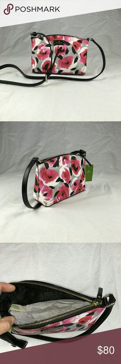 """Kate Spade Millie Grove Street Crossbody KATE SPADE MILLIE GROVE STREET PRINTED CROSS BODY ROSE BED NEW WITH TAGS RETAILS $199.00  GUARANTEED AUTHENTIC COMES FROM A SMOKE FREE HOME  PVC IN ROSE BED PRINT BLACK LEATHER TRIM FULL ZIPPERED TOP CLOSURE WITH BLACK LEATHER PULL 14 K GOLD PLATED HARDWARE KATE SPADE LICENSE PLATE ON FRONT BLACK LEATHER ADJUSTABLE STRAP HAS 20"""" DROP CROSS BODY MEASURES APPROXIMATELY 5 3/4' HEIGHT AND 10"""" LENGTH BOTTOM MEASURES ACROSS 8 1/2"""" DEPTH IS 3""""  INTERIOR IS…"""