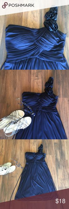 """Navy blue one shoulder dress Very flattering fit! Good used condition. No pets, smoke free clean home. Needs to be dry cleaned.. The strap was too long on me so I had it safety pinned it in. Satiny roses on shoulder strap! Navy blue. Ties in the back. Polyester. Armpit to hem is 27"""" long. 14.5"""" across bust. City Triangles Dresses Mini"""