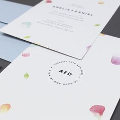 The Amelia Wedding Collection features original, hand-painted watercolour petals and pastel green foliage complimented with bold typography.