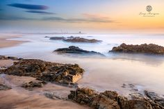 """SEA0133 - Beautiful rocks on the foreground with """"Leixões"""" sea dock at the background."""