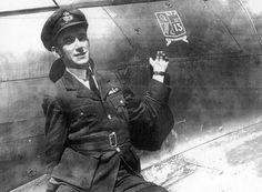 "F/O Derek H Ward of No 87 Squadron RAF points his hand to the artwork applied to Hurricane Mk I LK-M deployed to RAF Hullavington to extend the night defences in 1940. The aircraft was flown by P/O John R ""Johnny"" Cock on the night of 26 July to score his sixth victory. In one of the first successful nocturnal interceptions performed by No 10 Group, the 22-year-old Australian succeeded in knocking out a mine-laying He 111 in the glare of Bristol's searchlights."