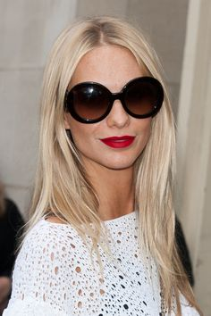 Poppy Delevingne sporting the perfectly chic red lipstick and black glasses combo.