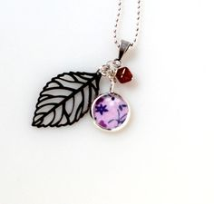 Charm Necklace Upcycled Leaf Vintage Fabric Charm Necklace. $15.00, via Etsy.