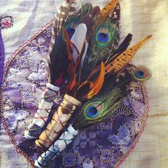 Feather, deerskin, and gemstone sage smudge fans
