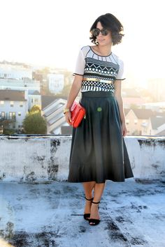 leather midi skirt, graphic tee shirt. great pairing!