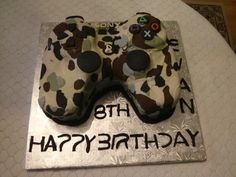 Playstation camo cake from QUEEN BEE EDIBLE ART