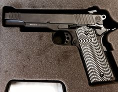 Taurus PT1911 with StonerCNC gripsLoading that magazine is a pain! Get your Magazine speedloader today! http://www.amazon.com/shops/raeind
