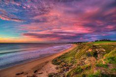 The Sun sets on a beach near Oamaru on the South Island, New Zealand