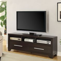 Features:  -Constructed with wood and metal hardware.  -Back panel material: Particle board.  Product Type: -TV Stand.  Color: -Cappuccino.  Frame Material: -Manufactured wood.  Design: -Cabinet/Enclo