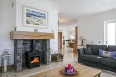 The home's sitting room (pictured) has a wood burning stove and French doors to the decked terrace, which has sea views Interior Design Living Room, Living Room Designs, English Cottage Style, Concrete Fireplace, Room Pictures, French Doors, Sweet Home, Lounge, Home Appliances