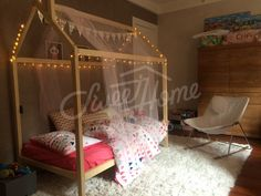 cozy girls room interior with lights and canopy toddler bed house bed frame