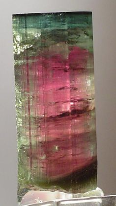Watermelon tourmaline is a well-known tourmaline variety named because of its unique coloration: With bands of green, pink/red and sometimes a thin strip of white in between them, its coloration resembles that of the watermelon, sometimes strikingly so.