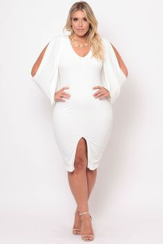 This plus size Grecian goddess inspired cocktail dress features stretch-knit fabric, a v-neckline, lining, a center seam, fully lined, front slit and draped col