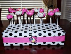 Cake Pop Holder: Like this idea with the black paper and red ribbon but for fruit skewers and not cake pops