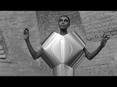 """Mirrored Sound-Sculpture dresses by Francois et Bernard Baschet dresses for the film """"Qui êtes-vous, Polly Maggoo?"""" (1966). Written and directed by William Klein."""