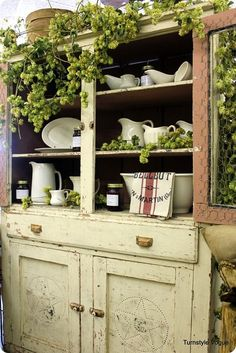 Rustic cabinet with chicken wire.  Great storage.